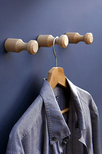 Hang it pegs carved from beech and used to hang shirts in the laundry room